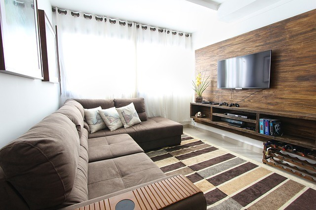 Living room with TV mounted on the wall